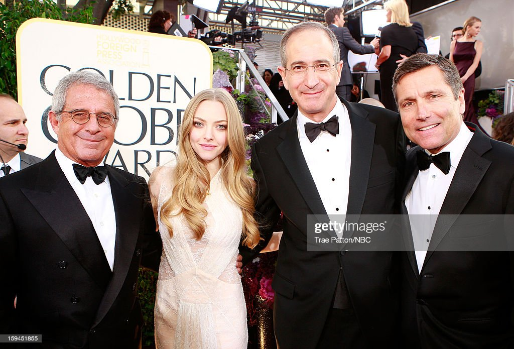 70th ANNUAL GOLDEN GLOBE AWARDS -- Pictured: (l-r) Ron Meyer, President and Chief Operating Officer, Universal Studios; actress Amanda Seyfried, Brian Roberts, Chairman and Chief Executive Officer, Comcast; and Steve Burke, Chief Executive Officer, NBCUniversal arrive to the 70th Annual Golden Globe Awards held at the Beverly Hilton Hotel on January 13, 2013.