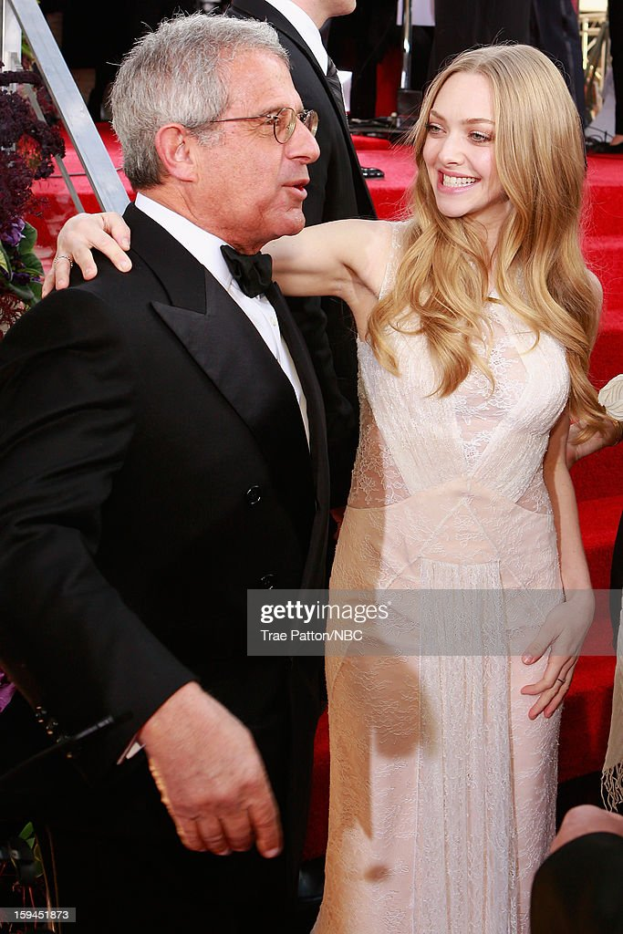 70th ANNUAL GOLDEN GLOBE AWARDS -- Pictured: (l-r) Ron Meyer, President and Chief Operating Officer, Universal Studios, and actress Amanda Seyfried arrive to the 70th Annual Golden Globe Awards held at the Beverly Hilton Hotel on January 13, 2013.