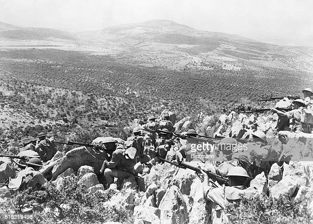 7/10/1941On the Syrian border This photo was made just before the Australian troops shown began their advance into Frenchmandated Syria in...