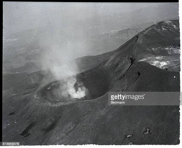 7/10/55Catania Sicily White smoke and hot lava continue to pour from the crater of Sicily's Mount Etna as tourists at nearby Taormina pack their bags...
