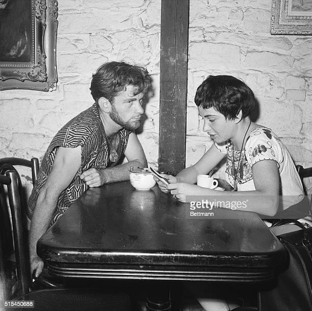 7/13/1959New York NY Poet Dick Woods sits at a table with Eddy Slaton in the Gaslight coffee house in Greenwich Village A setting for various...