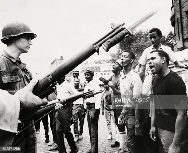 7/14/1967Newark New Jersey Negroes jeer at bayonetwielding National Guardsmen here July 14th The National Guard and New Jersey state police were...