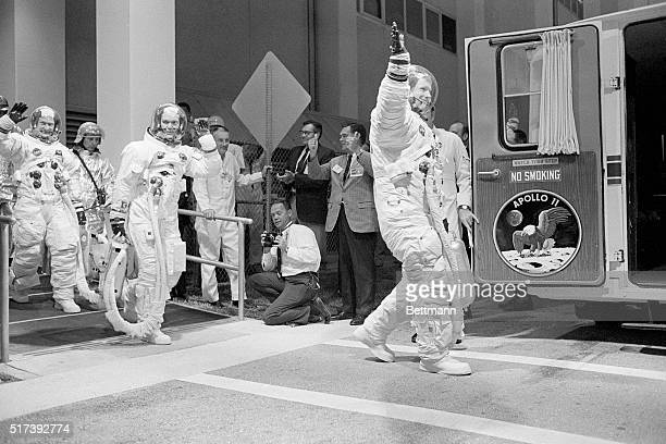 Kennedy Space Center FL Moonbound Apollo 11 astronauts Buzz Aldrin Mike Collins and Neil Armstrong step from crew quarters en route to the launch pad...