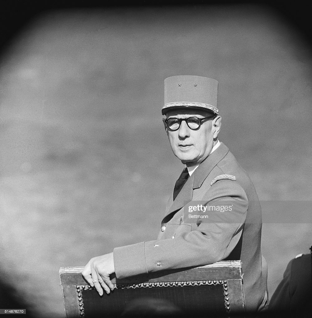 The 1959 Bastille Day Parade, an impressive celebration calculated to make every Frenchman's heart beat faster with emotion and pride, was the first under the Fifth Republic and it's founder, President Charles De Gaulle. Here, De Gaulle, clad in a khaki Brigadier General's uniform, turns in his seat on the reviewing stand to watch the parade.