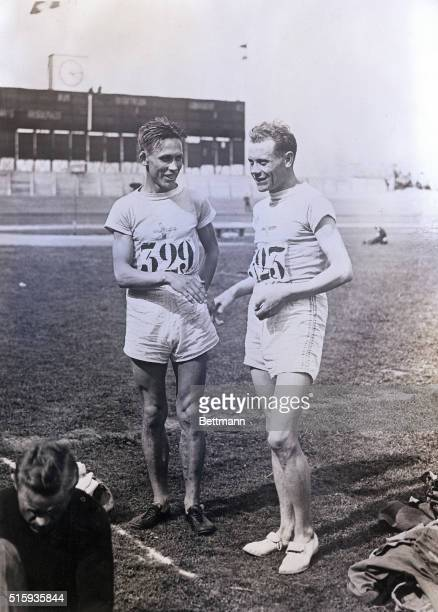 7/19/1924Paris France Finnish athletes Willie Ritola and Paavo Nurmi pose at Colombes Stadium during the 1924 Olympic Games