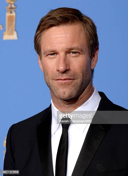 71st ANNUAL GOLDEN GLOBE AWARDS Pictured Actor Aaron Eckhart poses the press room at the 71st Annual Golden Globe Awards held at the Beverly Hilton...