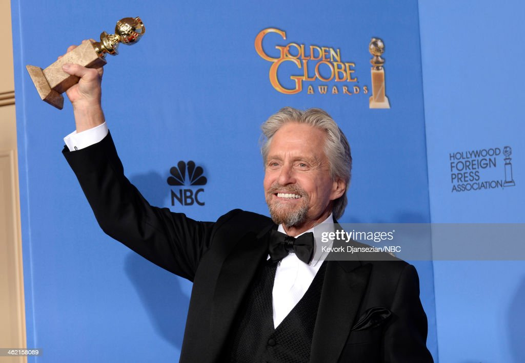 71st ANNUAL GOLDEN GLOBE AWARDS Pictured Actor Michael Douglas poses with his award for Best Performance in a Miniseries or Television Film for...
