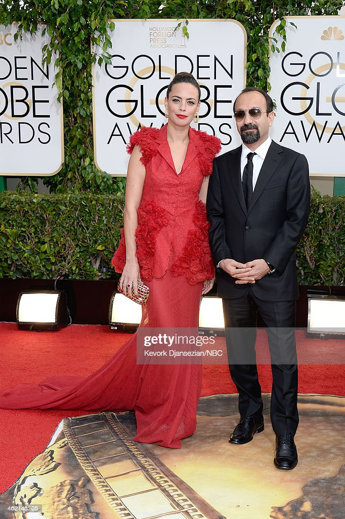 71st ANNUAL GOLDEN GLOBE AWARDS -- Pictured: (l-r) Actress Berenice Bejo and director <a gi-track='captionPersonalityLinkClicked' href=/galleries/search?phrase=Asghar+Farhadi&family=editorial&specificpeople=5700577 ng-click='$event.stopPropagation()'>Asghar Farhadi</a> arrive to the 71st Annual Golden Globe Awards held at the Beverly Hilton Hotel on January 12, 2014 --