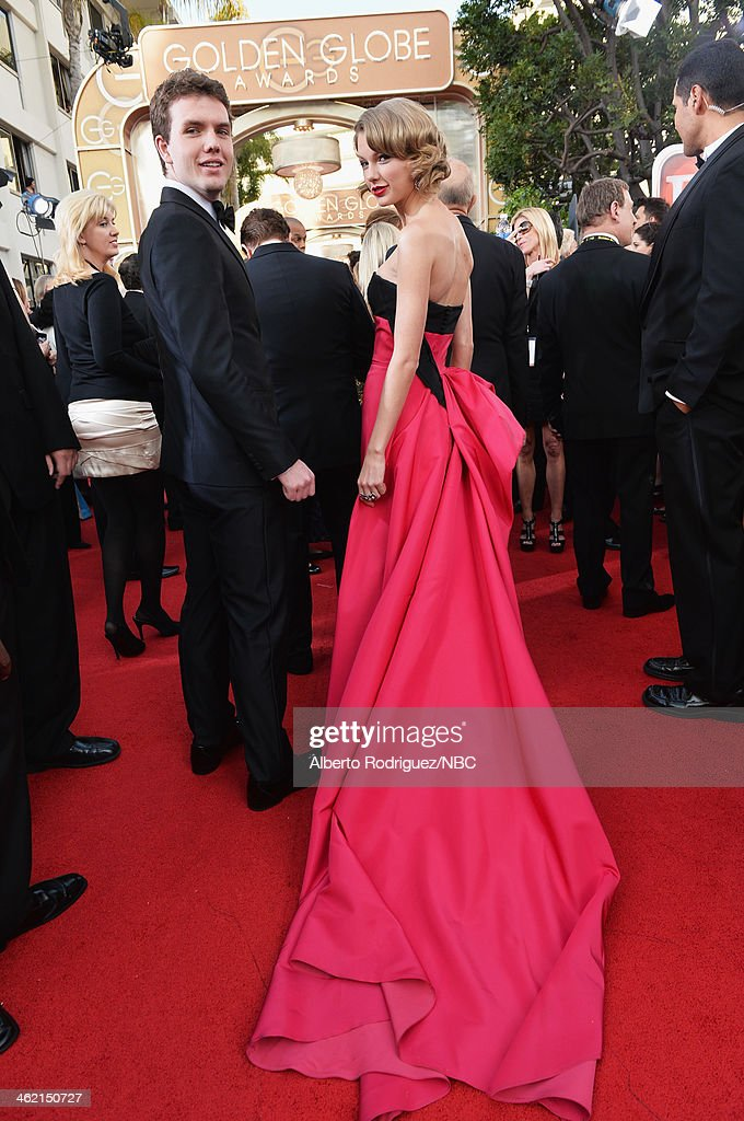 71st ANNUAL GOLDEN GLOBE AWARDS -- Pictured: (l-r) Austin Swift and singer <a gi-track='captionPersonalityLinkClicked' href=/galleries/search?phrase=Taylor+Swift&family=editorial&specificpeople=619504 ng-click='$event.stopPropagation()'>Taylor Swift</a> arrive to the 71st Annual Golden Globe Awards held at the Beverly Hilton Hotel on January 12, 2014 --