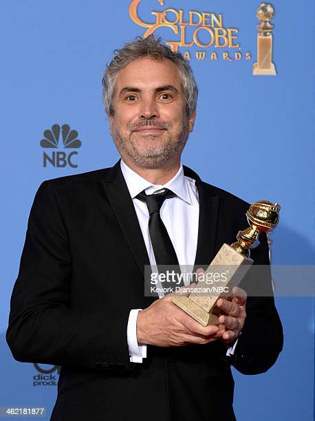 71st ANNUAL GOLDEN GLOBE AWARDS Pictured Director Alfonso Cuaron poses with his award for Best Director for 'Gravity' in the press room at the 71st...