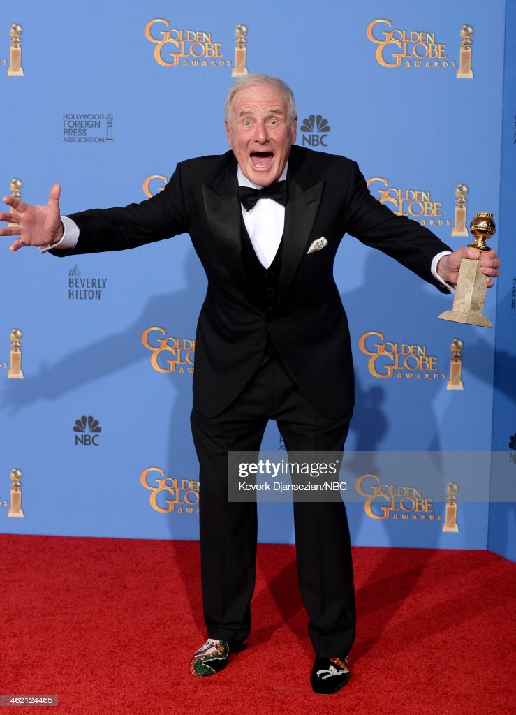 71st ANNUAL GOLDEN GLOBE AWARDS Pictured Producer Jerry Weintraub poses with his award for Best Miniseries or Television Film for 'Behind the...