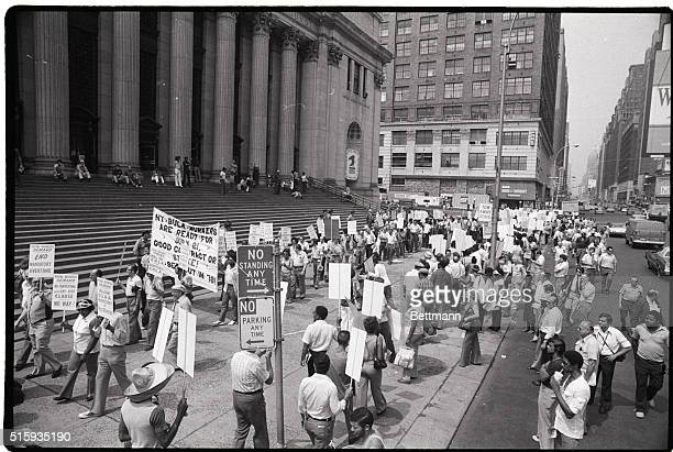 7/20/1978New York New York Post office workers carrying placards demonstrate outside the main Post Office at 34th Street and 8th Avenue as a...