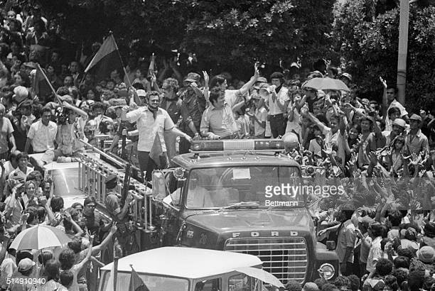 7/20/1979Managua NicaraguaMembers of the 5man junta of the Sandinista provisional government wave from the top of a fire truck as they enter the main...
