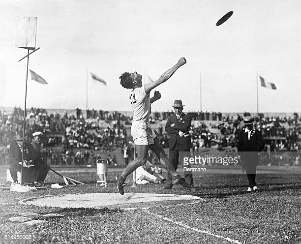 7/22/1924Paris France Bud Houser of California a member of the American Olympic Team is shown heaving the discus for a new record at the Olympic...