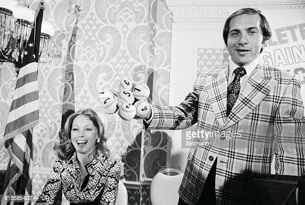 Johnny Bench 27yearold Cincinnati Reds' seventme AllStar catcher gets a laugh from his wife Vickie as he displays seven baseballsrepresenting seven...