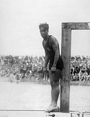7/25/1920Manhattan Beach CA Duke Kahanamoku of Hawaii is shown about to dive into the water during a farewell tournament at Manhattan Beach CA The...