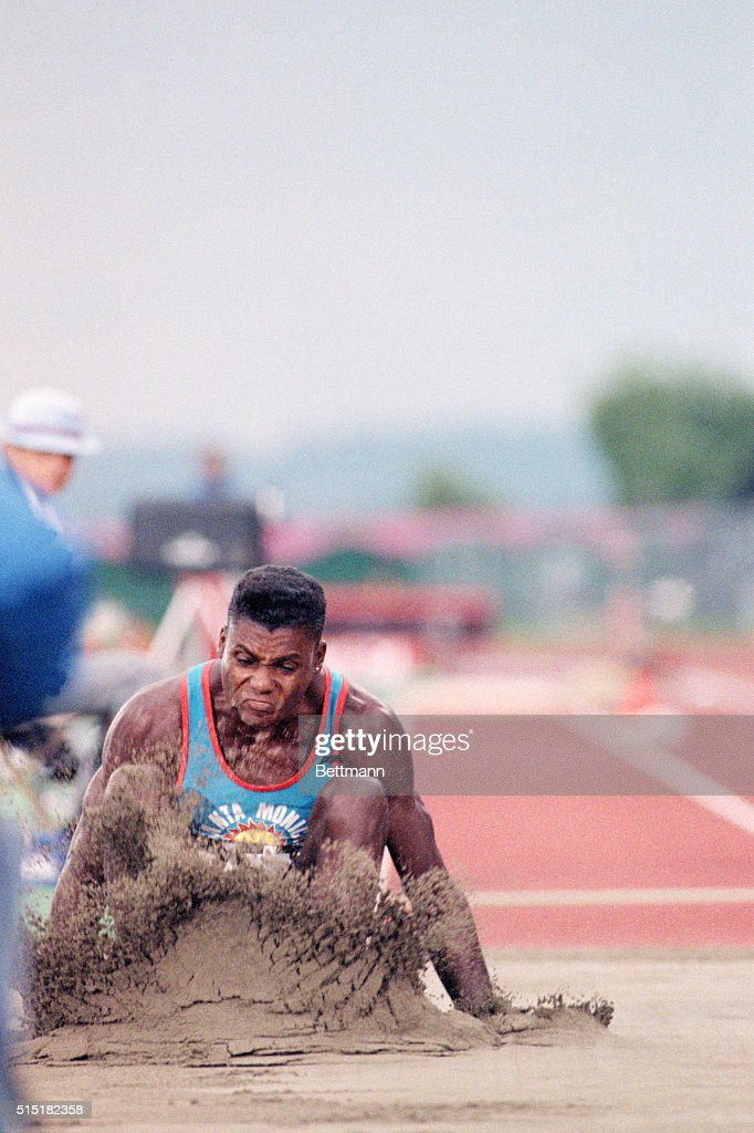 Seattle, WA- Carl Lewis touches down at 27'6' (8.38m) to win the gold medal in the long jump competition of the Goodwill Games. Lewis has a nine year winning streak in the event.