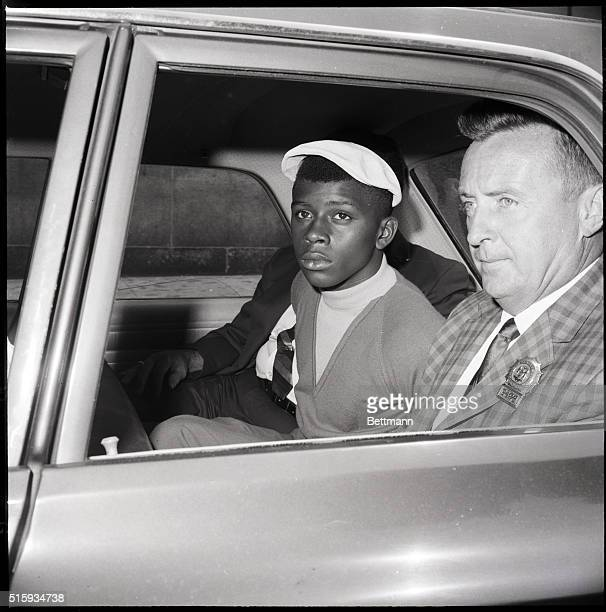 7/27/1966New York NY Ernest Gallashaw rides between two New York City detectives after his arrest on charges of firing the fatal shot that killed an...