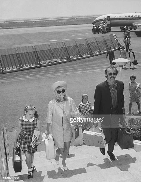 7/27/1967Nice French Riviera Wearing a proud moustache actor Sean Connery arrives at Nice Airport with his wife Diane Cilento and their daughter...