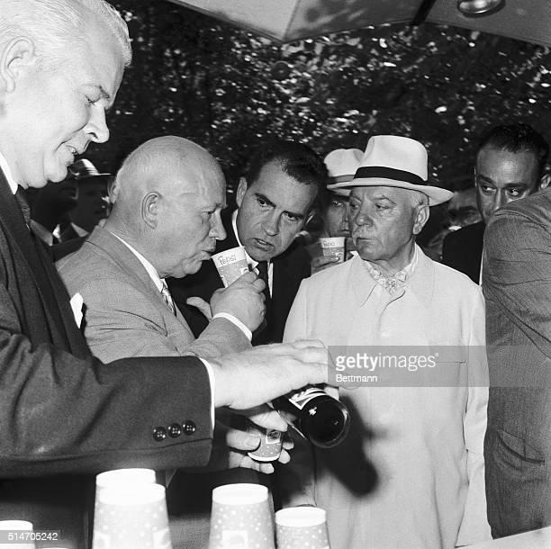 Under the intense scrutiny of US Vice President Richard M Nixon and Soviet President Klimenti Voroshilov Soviet Premier Nikita S Krushchev quaffs a...