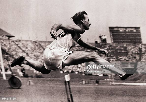 7/29/1948Wembley England Roy Cochran goes over a hurdle in trial heat on July 29 Cochran went on to cop the 400meter hurdle event at the Olympics in...