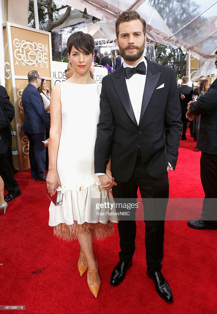 72nd ANNUAL GOLDEN GLOBE AWARDS -- Pictured: (l-r) Actress Amelia Warner and Jamie Dornan arrive to the 72nd Annual Golden Globe Awards held at the Beverly Hilton Hotel on January 11, 2015.