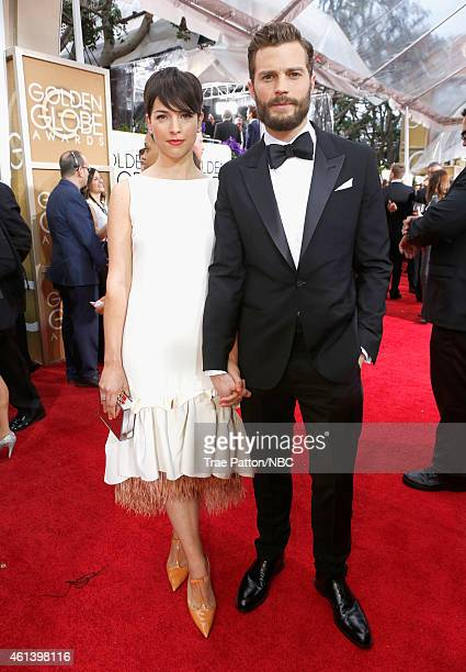72nd ANNUAL GOLDEN GLOBE AWARDS Pictured Actress Amelia Warner and Jamie Dornan arrive to the 72nd Annual Golden Globe Awards held at the Beverly...