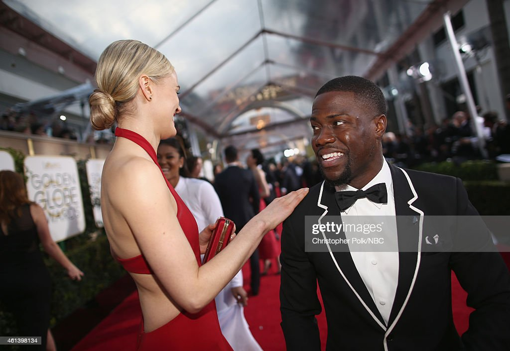 72nd ANNUAL GOLDEN GLOBE AWARDS -- Pictured: (l-r) Actress Taylor Schilling and comedian Kevin Hart arrive to the 72nd Annual Golden Globe Awards held at the Beverly Hilton Hotel on January 11, 2015.