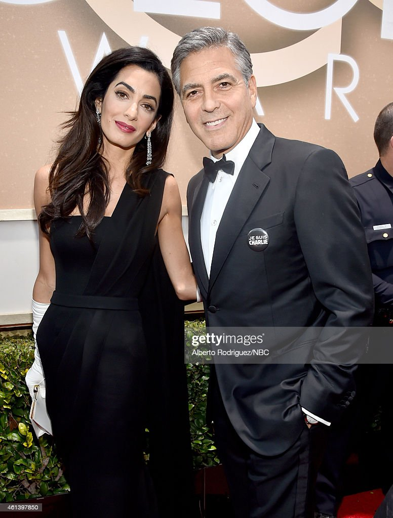 72nd ANNUAL GOLDEN GLOBE AWARDS -- Pictured: (l-r) Lawyer Amal Clooney and actor George Clooney arrive to the 72nd Annual Golden Globe Awards held at the Beverly Hilton Hotel on January 11, 2015.