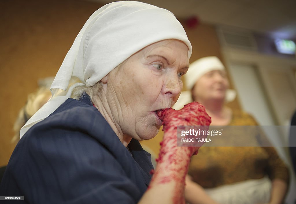 STORY 72-year old Estonian Siina Taal prepares Estonian blood sausage in Tallinn, Estonia, on December 15, 2012.As Christmas looms, residents of the Baltic state of Estonia are bracing to wolf down tonnes of blood sausage, a staple of their holiday table.
