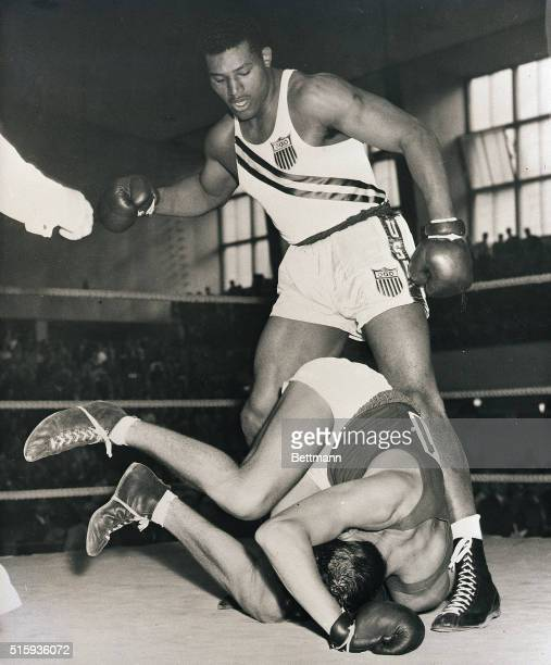7/31/1952Helsinki Finland America's Ed Sanders stands victorious over the crumpled form of his opponent Hans Jost of Switzerland after the yank...