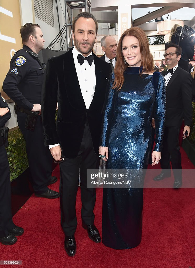 73rd ANNUAL GOLDEN GLOBE AWARDS Pictured Fashion designer Tom Ford and actress Julianne Moore arrive to the 73rd Annual Golden Globe Awards held at...