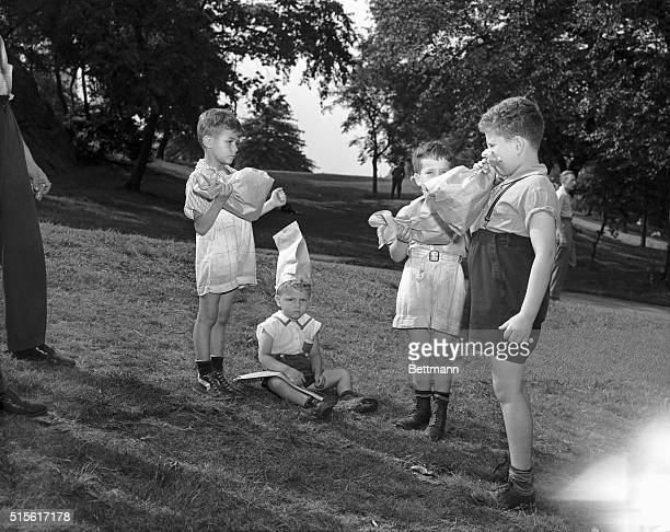 7/4/1942New York New YorkORIGINAL CAPTION READS These four youngsters undaunted by the lack of fireworks to play with reverted to the old trick of...
