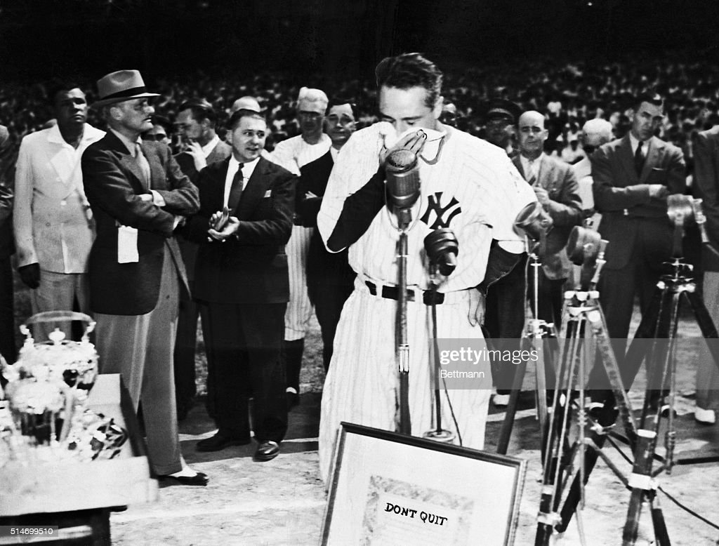 Lou Gehrig, the 'Iron Horse' of baseball, who was forced to the bency by amyotrophic lateral scherosis after playing 2,130 consecutive games, is touched by fans demonstration as he is acclaimed in a manner unrivaled in baseball history. Upwards of 75,000 jammed Yankee Stadium to honor Lou. He is shown here--handkerchief to his face, deeply moved by the ovation they gave him.