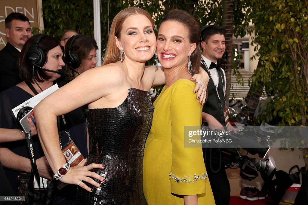 74th ANNUAL GOLDEN GLOBE AWARDS -- Pictured: Actors Amy Adams and Natalie Portman arrive to the 74th Annual Golden Globe Awards held at the Beverly Hilton Hotel on January 8, 2017.