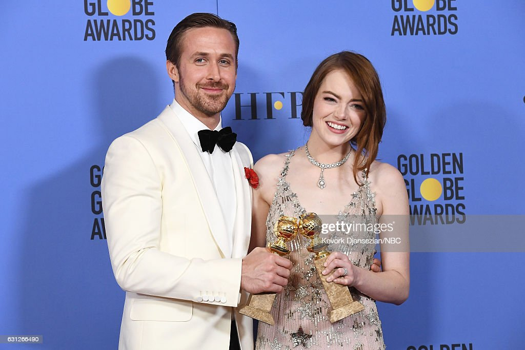 74th ANNUAL GOLDEN GLOBE AWARDS -- Pictured: (l-r) Actors Ryan Gosling and Emma Stone, winners of the Best Performance by an Actor/Actress in a Motion Picture — Comedy or Musical for 'La La Land', pose in the press room at the 74th Annual Golden Globe Awards held at the Beverly Hilton Hotel on January 8, 2017.