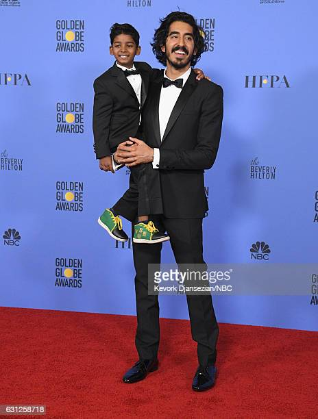 74th ANNUAL GOLDEN GLOBE AWARDS Pictured Actors Sunny Pawar and Dev Patel pose in the press room at the 74th Annual Golden Globe Awards held at the...