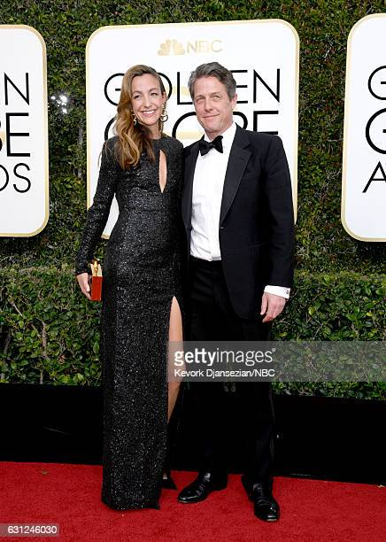 74th ANNUAL GOLDEN GLOBE AWARDS Pictured Producer Anna Elisabet Eberstein and actor Hugh Grant arrive to the 74th Annual Golden Globe Awards held at...