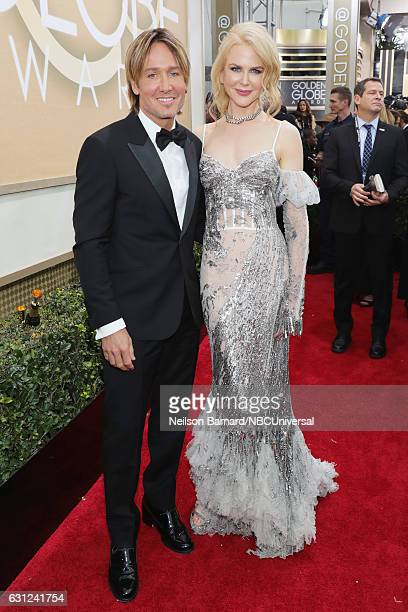 74th ANNUAL GOLDEN GLOBE AWARDS Pictured Recording artist Keith Urban and actress Nicole Kidman arrive to the 74th Annual Golden Globe Awards held at...