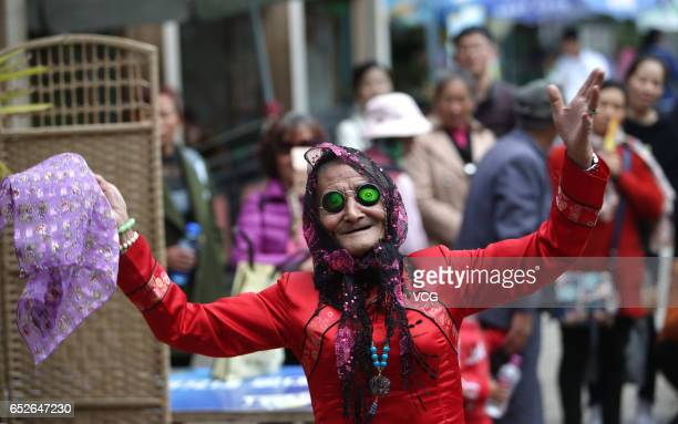 74yearold man Li Yinglai performs at a park on March 4 2017 in Kunming Yunnan Province of China Li Yinglai began to dress himself as a woman to...