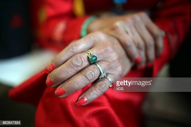 74yearold man Li Yinglai shows the rings given by his fans on March 4 2017 in Kunming Yunnan Province of China Li Yinglai began to dress himself as a...