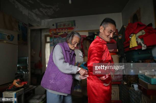 74yearold man Li Yinglai stays with his 96yearold mother on March 4 2017 in Kunming Yunnan Province of China Li Yinglai began to dress himself as a...