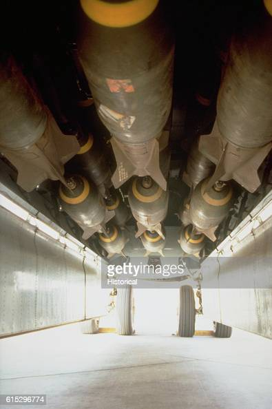 M117 750pound bombs loaded into the bomb bay of a B52G Stratofortress aircraft prior to a bombing mission against Iraqi forces during Operation...