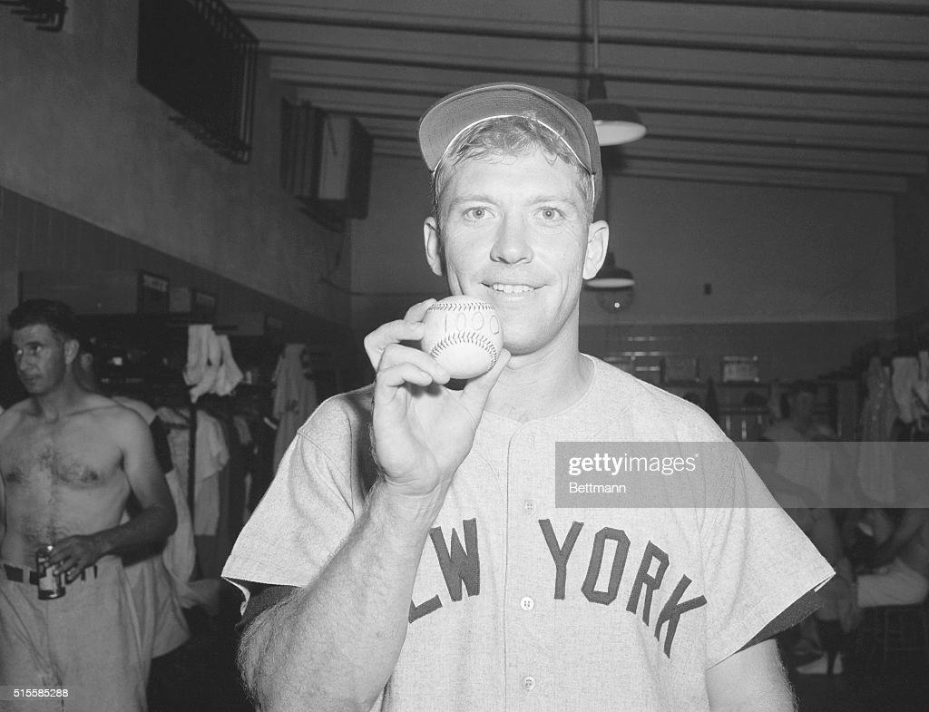 7/5/1957Washington DC New York Yankee slugger Mickey Mantle holds a baseball marked '1000' to indicate that he got his 1000th hit during the 8th...