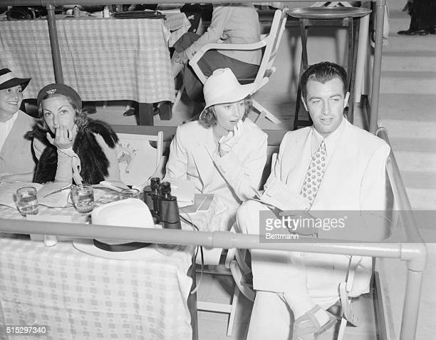 7/5/37Del Mar California Barbara Stanwyck and Robert Taylor pictured as they attended the opening of Bing Crosby's milliondollar racing plant at Del...