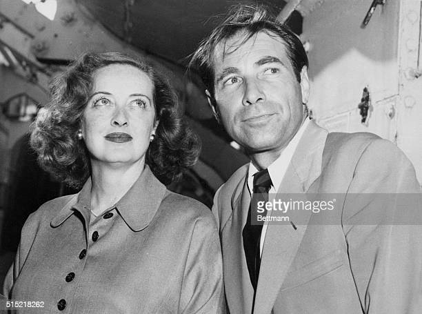7/5/51New York New York Screen actress Bette Davis and her slightly windblown husband actor Gary Merrill arrive in New York aboard the Queen...