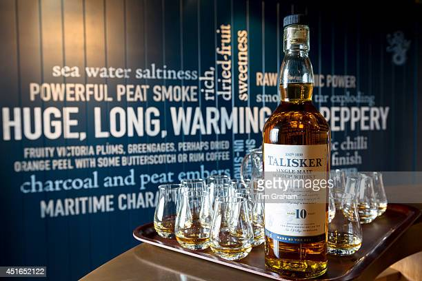 75cl bottle of 10 year old Talisker single malt Scotch Whisky and dram glasses for tasting as part of the visitors tour at the Distillery in Carbost...