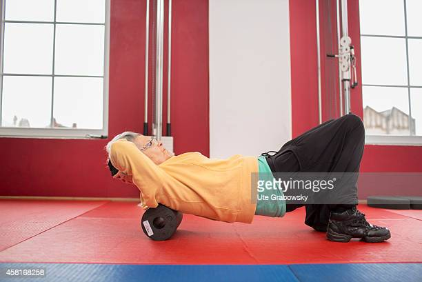 75yearold woman using a foam roller in a gym on October 09 in Bonn Germany The WHO recommends older adults to stay physically active in order to...