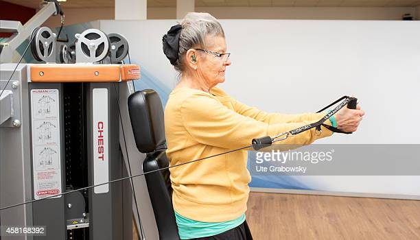 75yearold woman working out in a gym on October 09 in Bonn Germany The WHO recommends older adults to stay physically active in order to increase and...