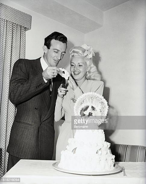 7/6/1943Las Vegas NVTrumpeter Harry James and his brandnew bride blonde curvesome Betty Grable cut themselves a piece of wedding cake after their...